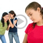 Why Do Children Bully? two young girls laughing behind another girls back
